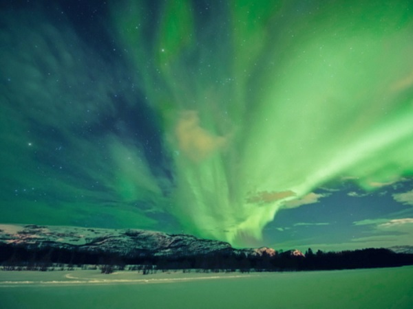 Northern lights, Aurora borealis, over the frozen river Gammelbollo, Sorrisniva, Alta, Norway.
